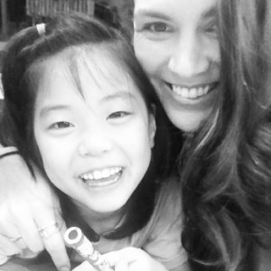 Jessie McShane (right) with a child from GyeongAeWon Orphanage in Mokpo, South Korea