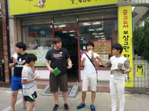 Volunteer Shaun Wiese and a group of kids