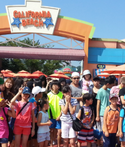 Michael (white hat / sunglasses) with kids from the Gumi orphanage at the water park they visited this summer
