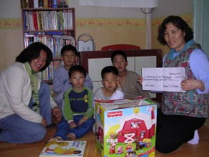 January 2005, First toy donations to Samsungwon (Aimee Jachym, left)