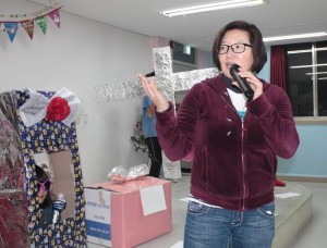 KKOOM President, Aimee Jachym, presides over the Christmas Party closing ceremony.