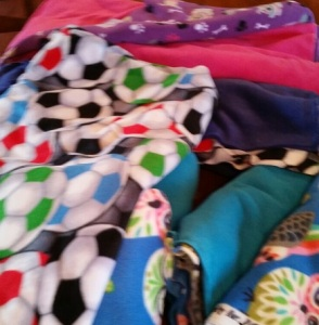Some of the fabric Lisa has collected to make more blankets for children in Korean orphanages