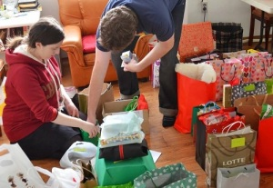 Anna (left) and another volunteer organize Christmas presents at Samsungwon