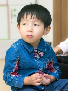 Minho at an orphanage in Daegu, South Korea