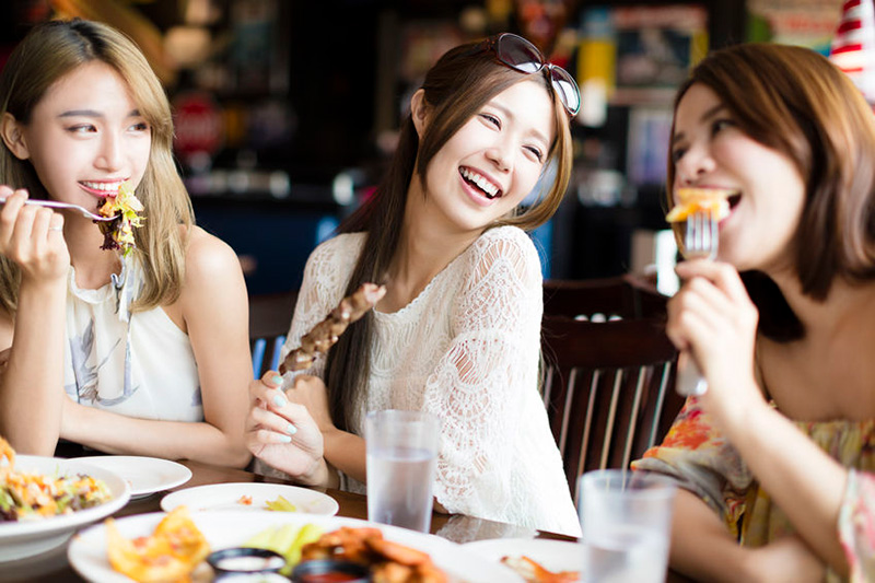 Girls eating at restaurant